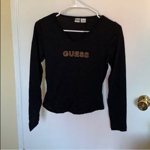 "Black long sleeve top with ""Guess"" brand logo"
